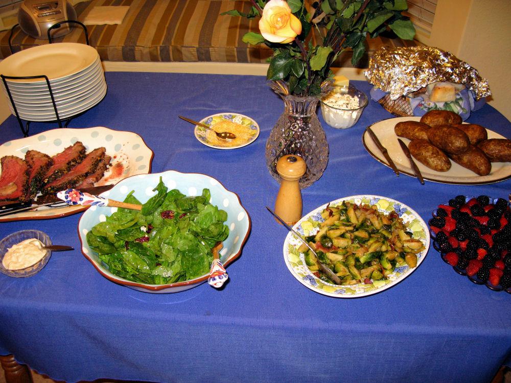 Prime rib, salad, Brussels sprouts, blackberries & strawberries, rolls