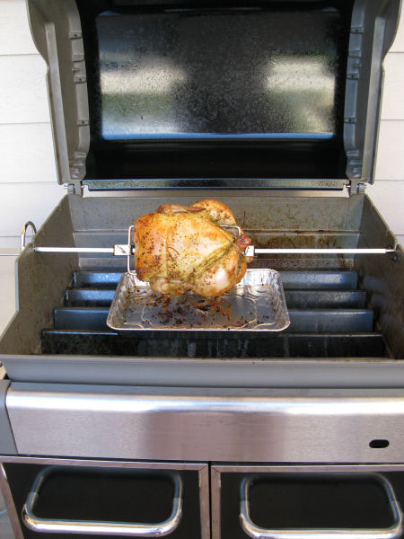 You'll need to remove the grill racks to make room for the chicken to rotate on the spit