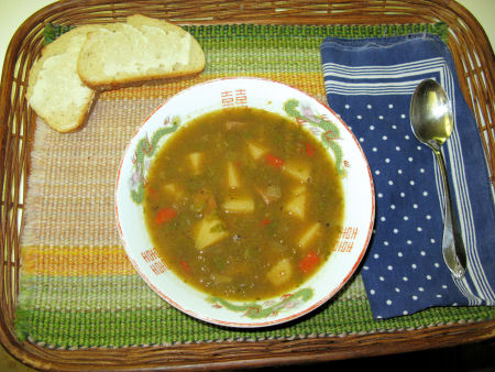 New Mexico stew (in a Chinese bowl . . . with French bread)
