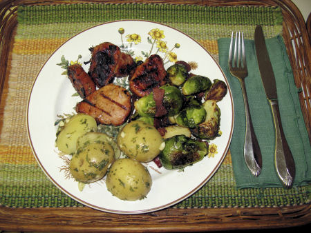Jerk pork medallions w/potatoes & Brussels sprouts